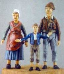 Man, Woman & Child in Country Dress